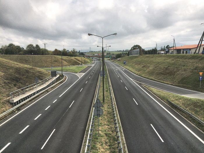 Road Transportation Road Marking The Way Forward Landscape Diminishing Perspective Cloud - Sky Sky Field Cloud Outdoors Vanishing Point Day Dividing Line Cloudy Nature Curve Non-urban Scene Country Road Long Dramatic Angles