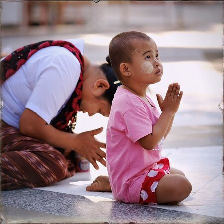 Praying young boy at Swedagon Pagoda, Yangon, Myanmar