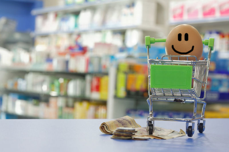 Financial and consumerism concept Counter Shop Interior Blurred Background Cart Shopping ♡ Trolley Consumerism Concept Conceptual Money Coins Financial Buying Power Happy Close-up Pharmacy Checkout