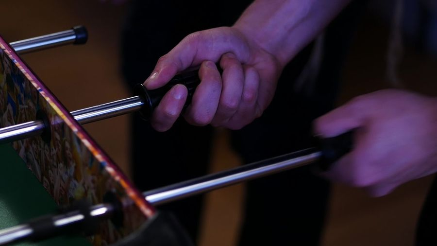 Close-up of hand playing foosball