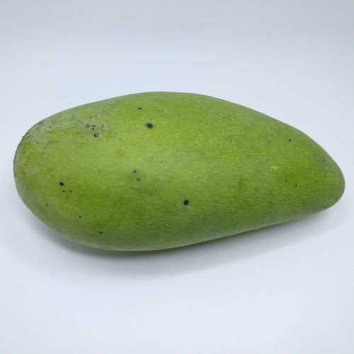 High angle view of green fruit against white background