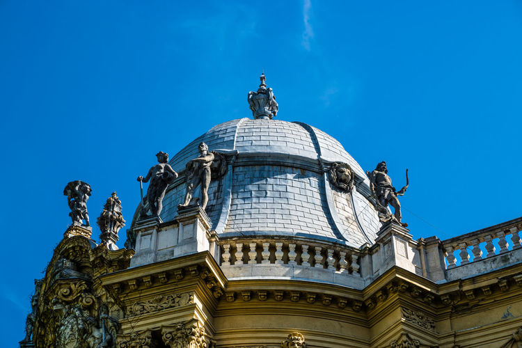 High section of domed structure against blue sky