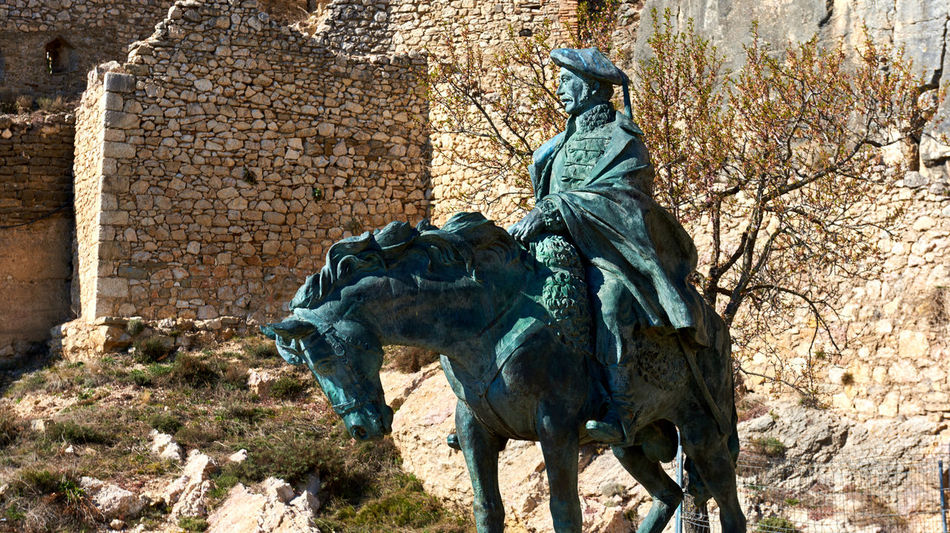 Equestrian statue of Ramon Cabrera at Castell de Morella. Province of Castellon, Valencian Community, Spain. Ancient Bronze Sculpture Bronze Statue Castellón Equestrian Statue Europe Fortification History Horse Landmark Maestrazgo Memorial Monument Morella National Landmark Old Outdoors Ramon Cabrera Ruined Castle Sculpture Sightseeing SPAIN Statue Sunny Day Travel Destinations