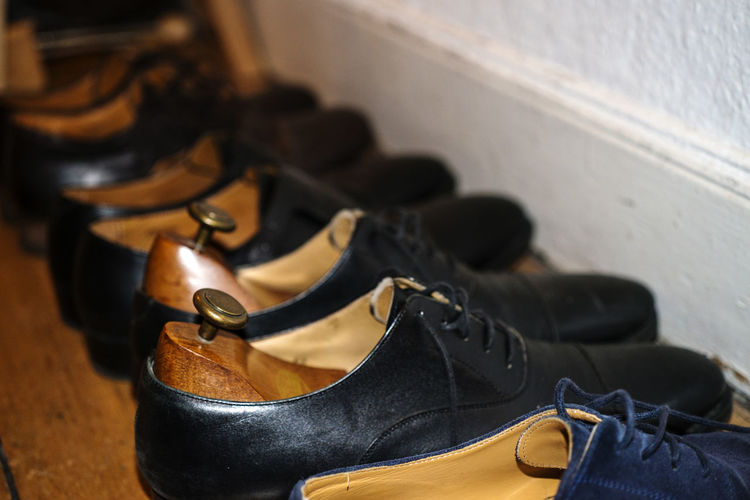 Close-up of footwear in row