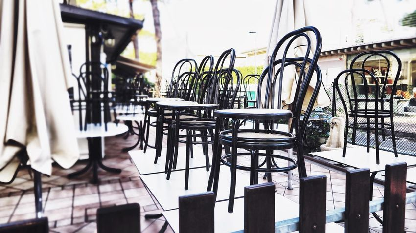 Bistro Cleaning On The Way Sitting Sitting Outside Bar Cafe Chair Clean Cleaned Close-up Closed Day Early Morning Fence Italy Milano Marittima No People Parasol Restaurant Stacked Stacked Chairs Streetphotography Table