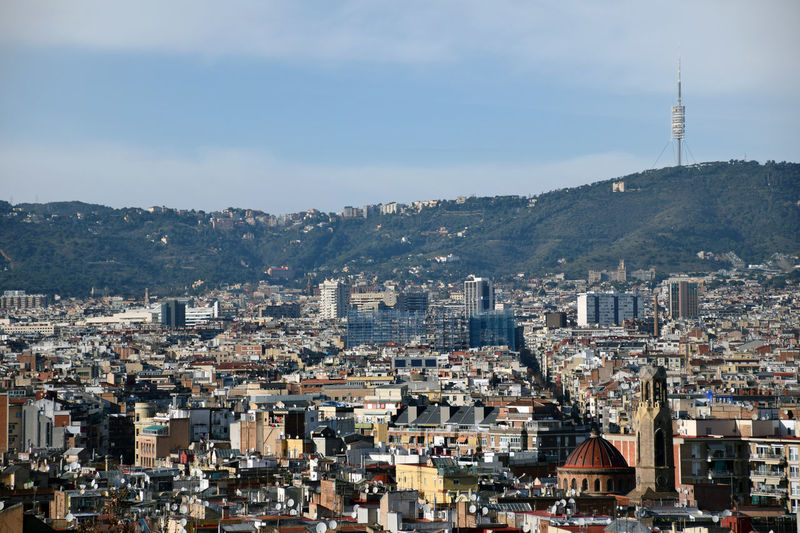 Barcelona's urban landscape. Collserola tower on background. Crowd City Europe Crowded City Landscape Urban Landscape Residential District Cityscape Landscape High Angle View Day Outdoors Building Travel Destinations
