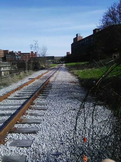 tracks to goodyear Gravel Industrial Landscapes 1 Point Perspective Tree Buildings & Sky Railroad Track Railroad Tie