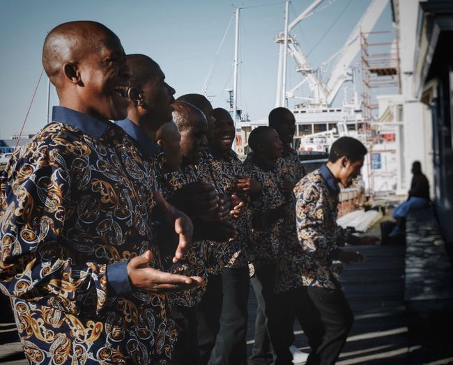 South African choir by the Waterfront Cape Town Capetown South Africa Outdoors Standing Togetherness Fun Leisure Activity Commercial Dock Singers Choir  Outdoor Singing African African Music African Choir VSCO Vscocam VSCO Cam Vscophile Vscofilm The Week On EyeEm People And Places