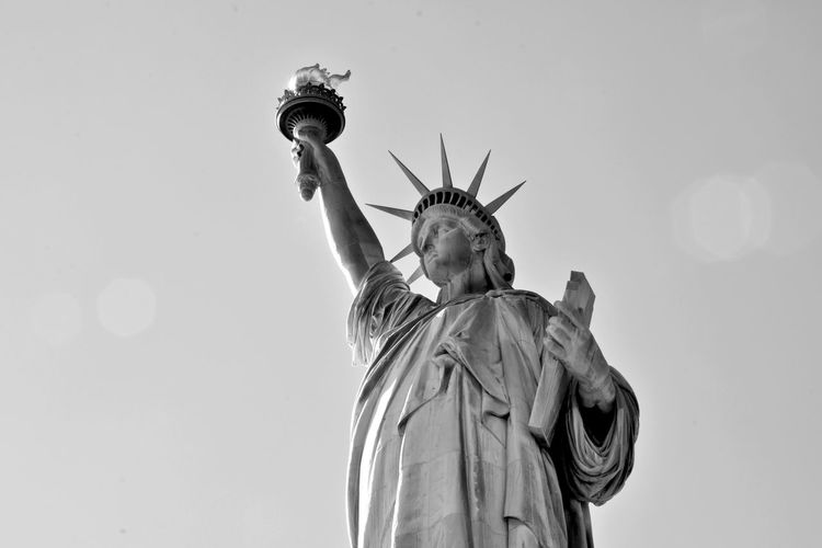 Liberty Island Statue Of Liberty Black And White Clear Sky Copy Space Day Female Likeness Freedom History Independence Lady Liberty Low Angle View No People Representation Sculpture Sky Statue Travel Travel Destinations