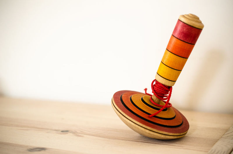 Close-up of toy on table against white background