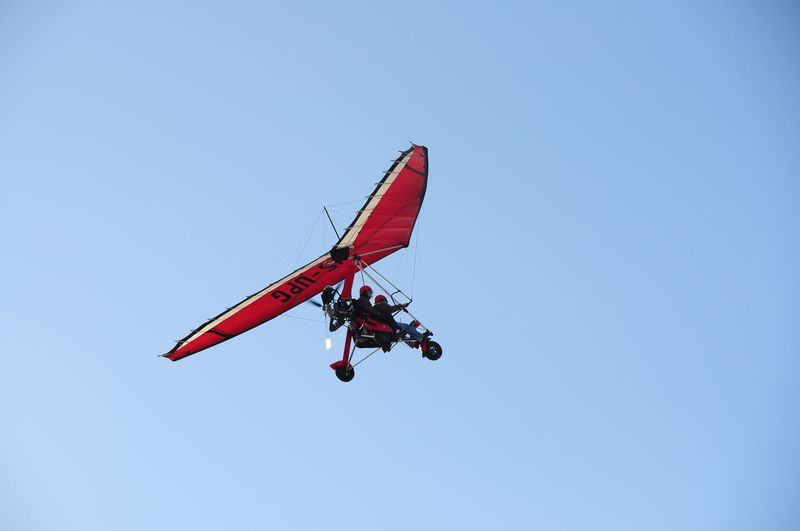 Low angle view of hang glider against clear sky