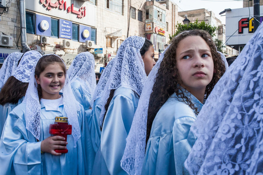 Christian Orthodox Palestinian celebrating Easter in Ramallah, Palestine. 2018. Christianity Middle East Palestine The Photojournalist - 2018 EyeEm Awards Architecture Child City Clothing Day Females Leisure Activity Lifestyles Looking At Camera People Portrait Teenager Women