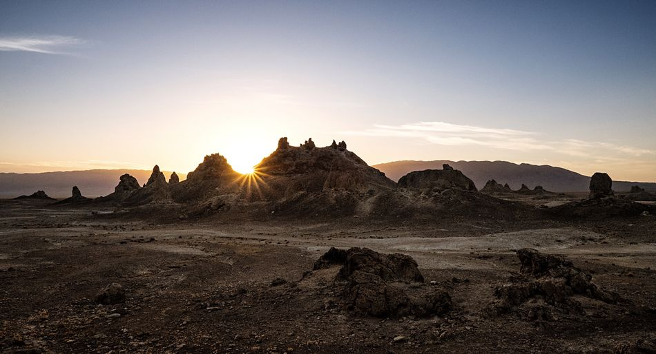 Scenic view of sunset at trona pinnacles against sky
