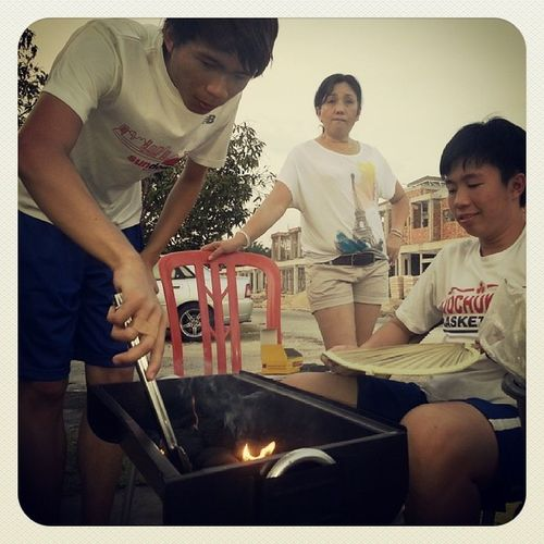 Preparing the barbeque pit.