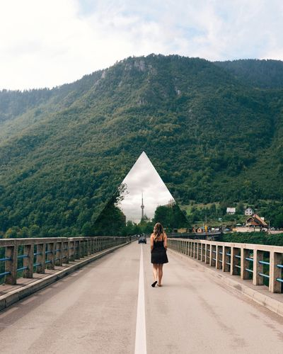 The city crossovers continue, and so do the mountains Bridge Bridge - Man Made Structure Citycross Dreaming Girl In Dress Montenegro Mountains Mountais One Person Rear View Tara Bridge Walking