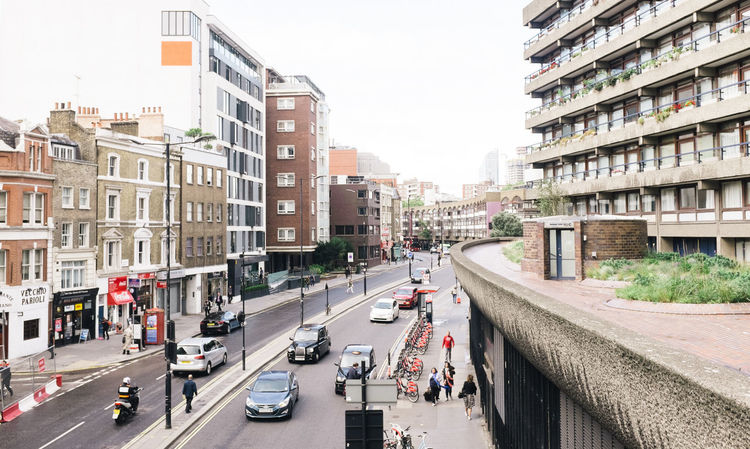 Barbican VSCO X100S Architecture Building Exterior Built Structure Car City City Life Clear Sky Day Fujifilm_xseries Group Of People Land Vehicle Large Group Of People Outdoors People Real People Road Sky Street Transportation Vscofilm