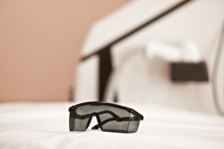Close-up of sunglasses on table at home