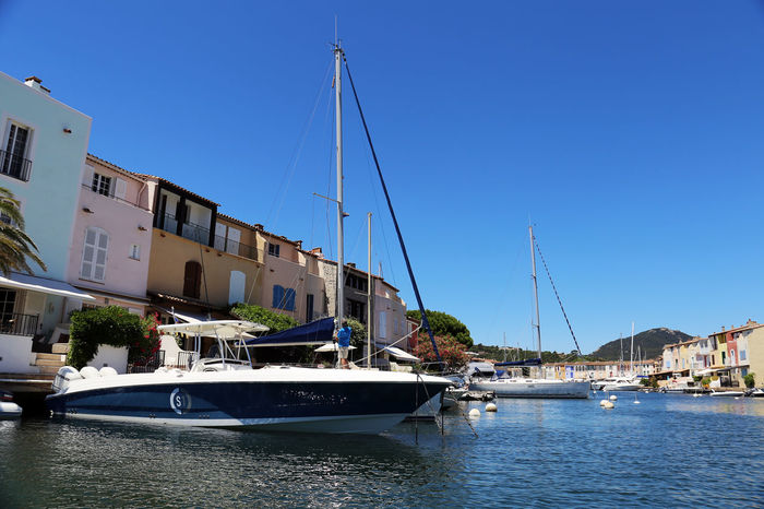 Boat in the street on the water in port Grimaud, France Blue Boat Boats Built Structure City City Life Clear Sky Day France Grimaud Mode Of Transport Nature Nautical Vessel No People Outdoors Sailboat Sailing Sky Tourism Travel Travel Destinations Travel Photography Travelphotography Water Waterfront