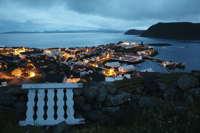 the fence. Honningsvag Norway Hills Hiking Oceanview Cityview Water Mountain Rocks Fence Landscape Sea Sky Illuminated Outdoors Harbor Port Summernight