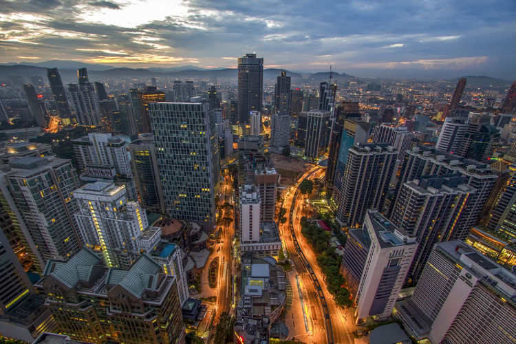 High angle view of kuala lumpu against cloudy sky at dusk