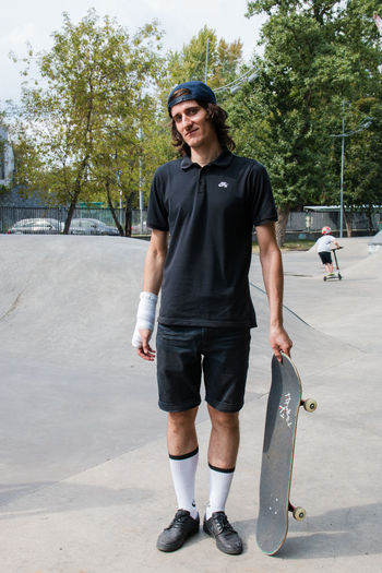 Skateboarder Casual Clothing Day Front View Full Length Glasses Happiness Leisure Activity Lifestyles Looking At Camera Nature One Person Outdoors Portrait Real People Smiling Sport Standing Tree Young Adult Young Men Skate Photography: Same Tricks, New Perspectives