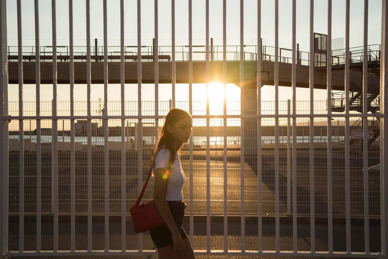 One Person Women Sunlight Fence Adult Barrier Streetwise Photography