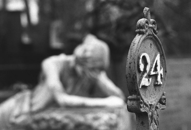 35mm Film Analogue Photography B&W Collection B&w Photography Cementery Corrosion Erossion EyeEm Best Shots Focus On Foreground In Poland Meditation Place Powązki Religion Sadness Sculpture Sign 2 Warsaw Woman's Monument