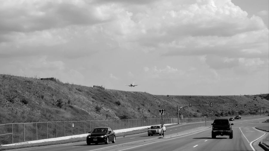 Transportation Driving On The Road Automobiles Cars Traffic Lights Traffic Signal High Ground Nashville Airport Plane Flying Plane Landing Through The Windshield Black And White Photography