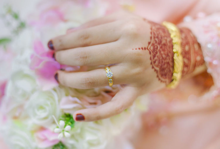 Close-up of bride hand holding bouquet