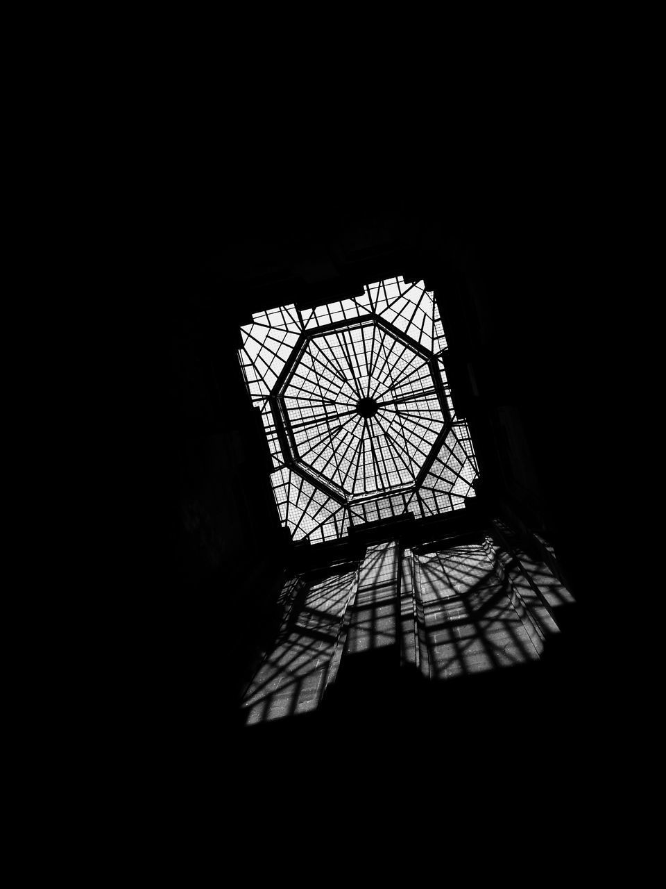 copy space, indoors, no people, architecture, silhouette, built structure, pattern, nature, low angle view, dark, window, day, building, sky, sunlight, close-up, metal, focus on shadow