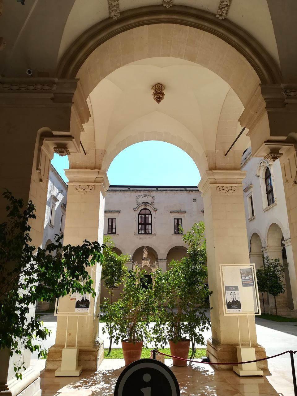 arch, architecture, built structure, building, building exterior, religion, day, spirituality, place of worship, plant, no people, belief, nature, the past, potted plant, history, sunlight, outdoors, architectural column, ceiling, courtyard, arched
