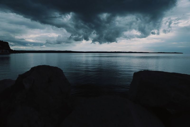Enter the sea Sky Cloud - Sky Water Beauty In Nature Scenics - Nature Storm Sea Tranquility Tranquil Scene Nature No People Storm Cloud Idyllic Land Overcast Horizon Over Water Beach Power In Nature Horizon
