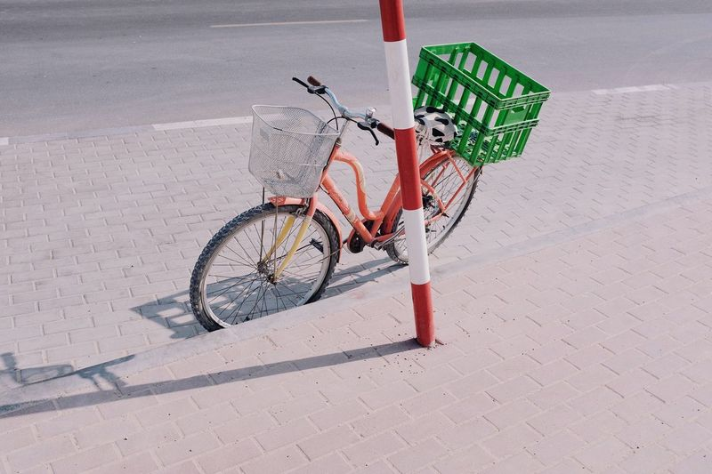 High angle view of bicycle parked on footpath