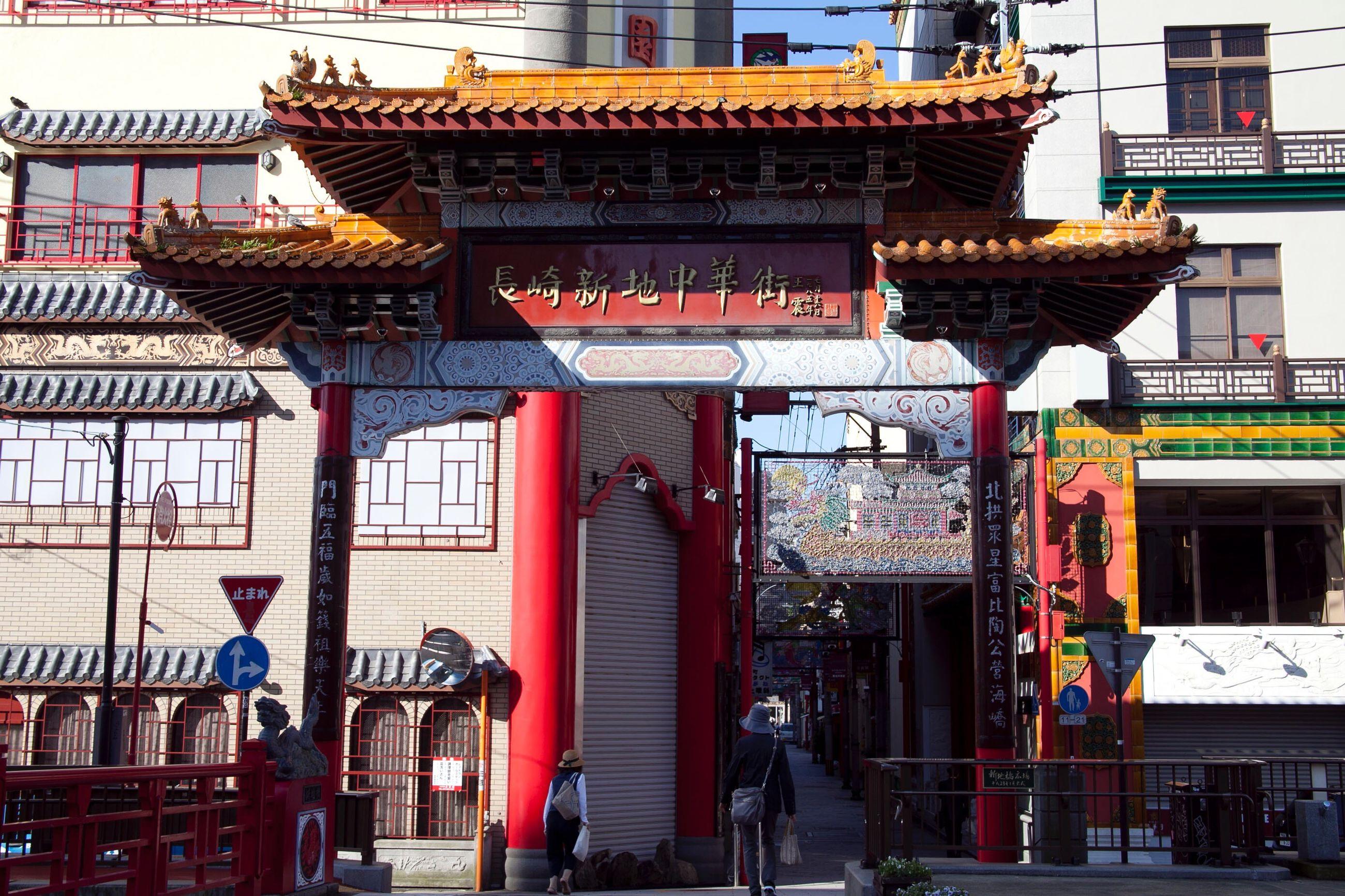 architecture, entrance, cultures, city, non-western script, travel destinations, built structure, building exterior, text, sky, day, outdoors, people