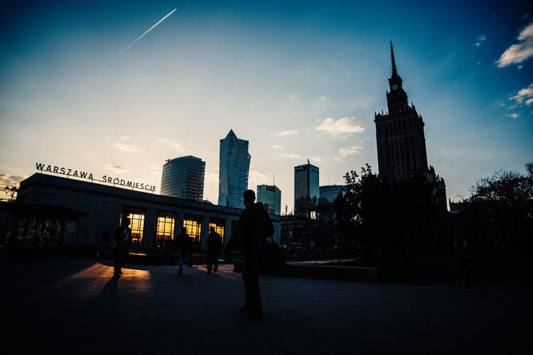 Warsaw in Spring The Week on EyeEm Light And Shadow Spring Street Photography Capture The Moment Nikon D750 Traveling City Life Architecture Built Structure Building Exterior Sky City Building Office Building Exterior Tall - High Tower Skyscraper Real People Travel Destinations Nature Men Lifestyles Modern Silhouette Travel People Outdoors Cityscape Spire  Financial District