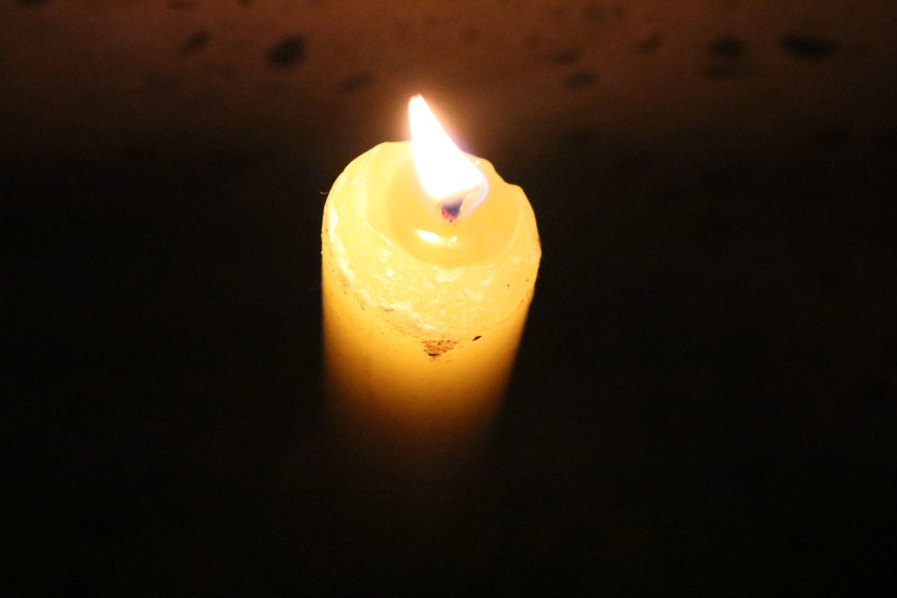 flame, candle, heat - temperature, burning, fire - natural phenomenon, glowing, illuminated, lighting equipment, darkroom, melting, close-up, no people, indoors, yellow, night, diya - oil lamp, black background