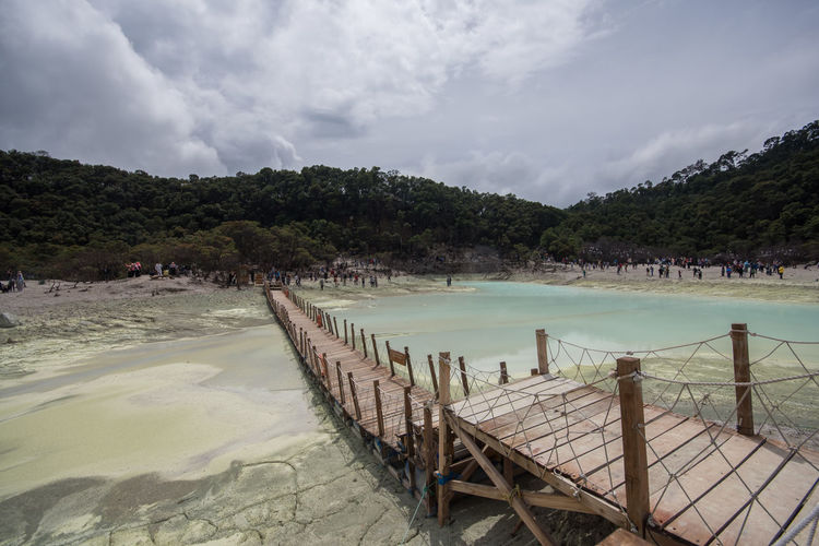 The Sulfur Lake at White crater or Kawah Putih in Ciwidey West Java, Near Bandung city, Indonesia Sky Water Cloud - Sky Tree Nature Beauty In Nature Scenics - Nature Beach Plant Land Tranquil Scene Tranquility Day No People Sea Non-urban Scene Outdoors Wood - Material Mountain