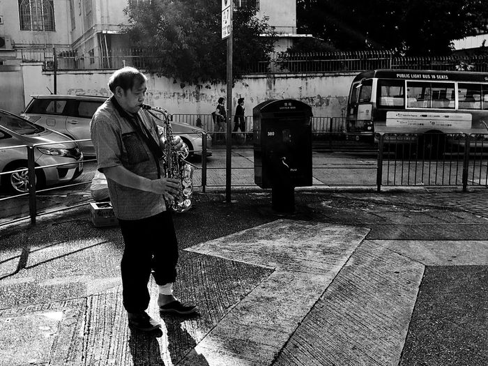 Street Photography Street Artist Street Musician City Light And Shadow People Watching IPhoneography Man Standing Black And White Black & White Snap A Stranger