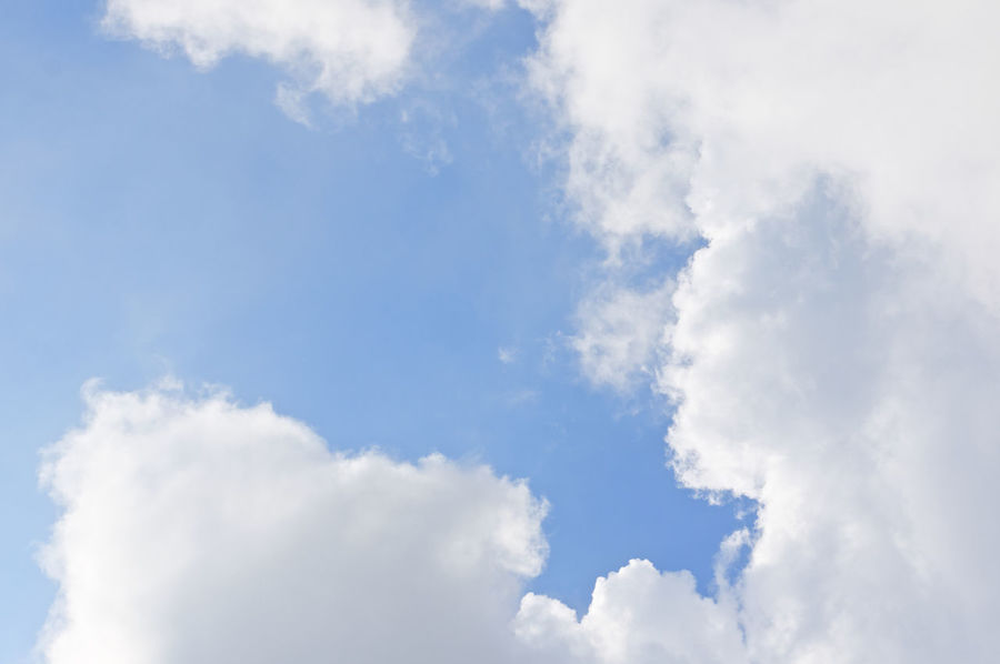 White cloud on right and bottom of blue sky as a background. Atmosphere Beautiful Cloud Heaven High Peace Scenic Weather Air Background Blue Climate Cloudscape Cumulus Day Daylight Meteorology Moisture Nature Nebulosity Outdoor Season  Sky Tranquility White