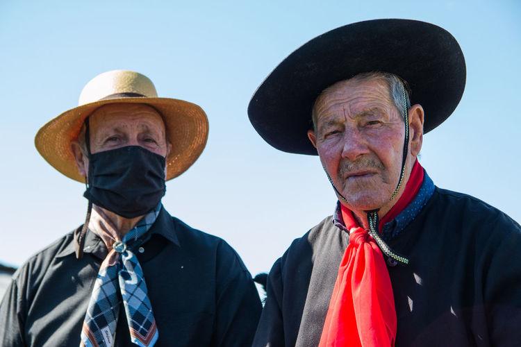 Portrait of senior men wearing hat against sky
