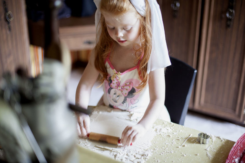 A three-year-old red haired girl plays with a rolling pin and kinetic sand (pretending it is pizza dough) in her kitchen on a weekend morning. Cooking Fun Happy Morning Pizza Dough Red Head Blond Hair Casual Clothing Childhood Day Dough Food Girls Home Interior Indoors  Kitchen One Person People Play Real People Red Hair Rolling Pin Standing Toddler  Veil
