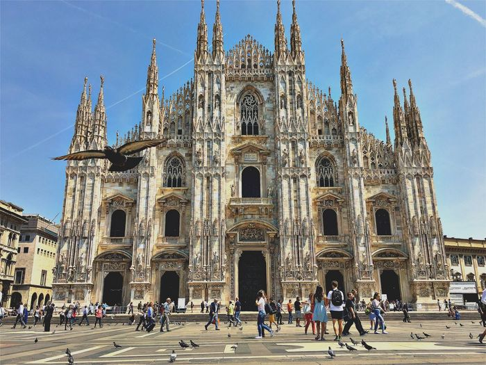 Bird Milano Popckorn Dove Religion Place Of Worship Spirituality Architecture Built Structure Building Exterior Real People Tourism History Travel Destinations Travel Men Façade Day Vacations Women Sky Leisure Activity Lifestyles