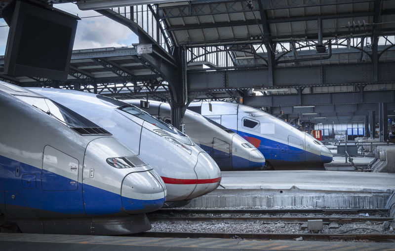 Four different types of high-speed modern trains, stationed in the train station from Paris, France. Paris Travel Arrival Business Gare Du Nord Infrastructure Mode Of Transportation No People Public Transportation Railroad Railroad Station Stationary Technology Train Station Trains Transportation Travel