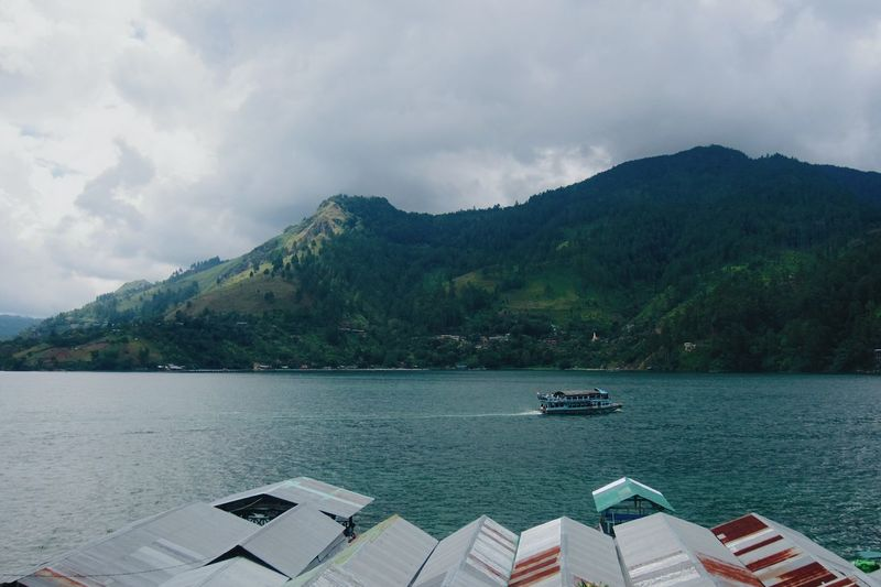 Lake Toba or Danau Toba in north Sumatra, INDONESIA is the biggest volcanic lake on earth. In 2013, I had the opportunity to visit it :) Mountain Water Cloud - Sky Scenics Beauty In Nature No People Nautical Vessel Nature Outdoors Landscape Day Cloud