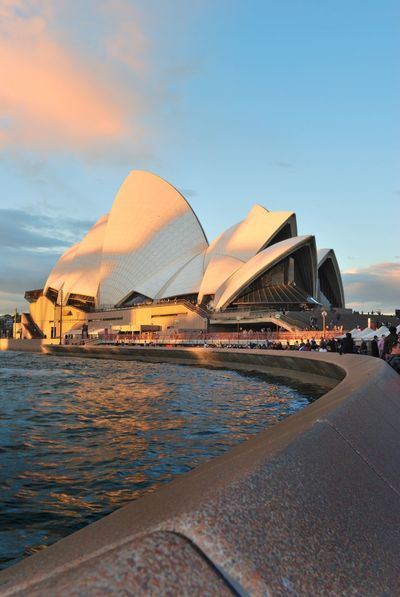 Sunset at Sydney Opera House Architecture Building Exterior Built Structure City Day Modern No People Outdoors Sky Sydney Sydney Opera House Travel Destinations Water