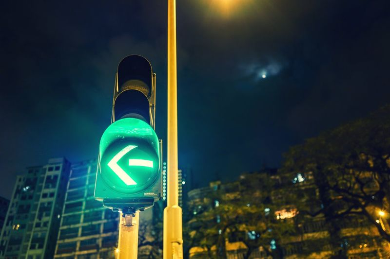 signal Nightshooters Discoverhongkong Illuminated Night Guidance Stoplight Outdoors Building Exterior Architecture No People Road Sign Focus On Foreground Built Structure Communication City Blue Sky Close-up