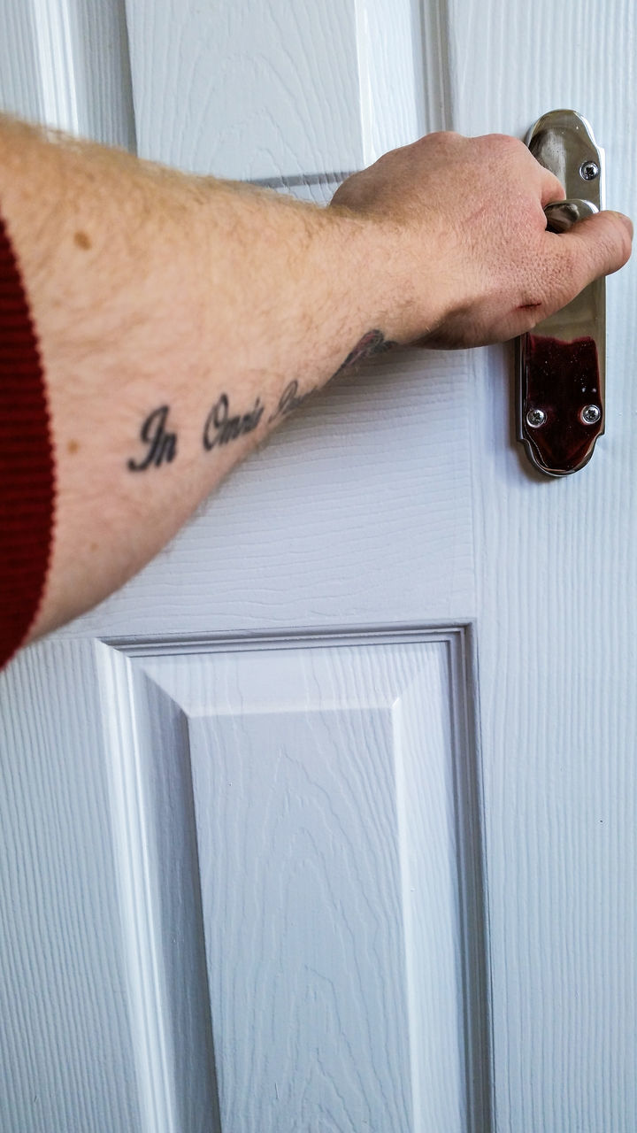 Cropped Image Of Man Opening Door