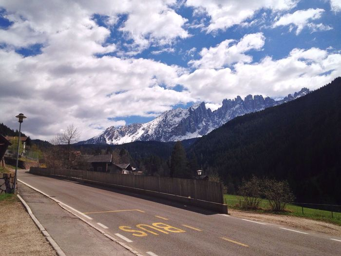 97/365 April 7 2017 One Year Project South Tyrol Italy Latemar Bus Station Mountain Sky Road Mountain Range Cloud - Sky The Way Forward No People Transportation Beauty In Nature Outdoors Day Scenics Nature