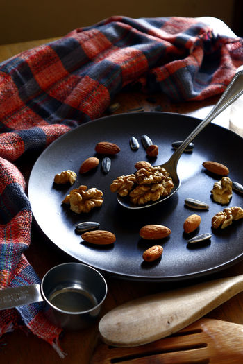 walnut, almond nuts and sunflower seeds on a plate Sunflower Seed Sunflower Seeds Plate Spoon Utensils Nuts Plate Taste Flavor Ingredient Ingredients Health Diet Nutrition Snacks! Snack Time! Food Nuts Dessert Close-up Food And Drink Almond Walnut Nut - Food