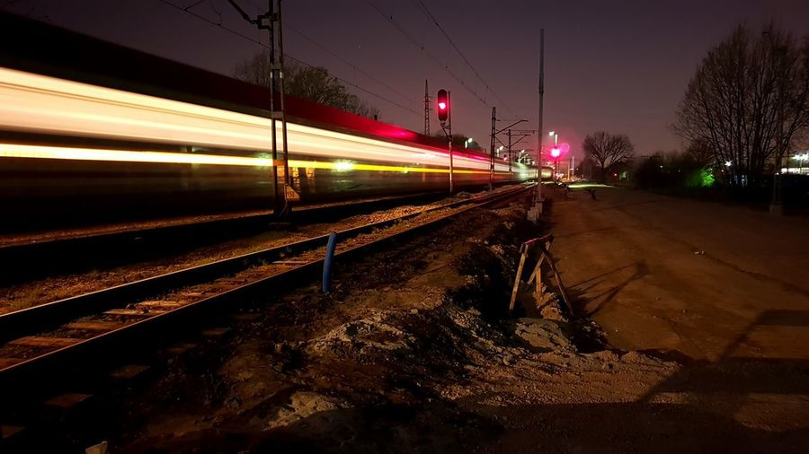 Illuminated City Public Transportation Speed Railroad Track Motion Long Exposure Train - Vehicle Light Trail Blurred Motion